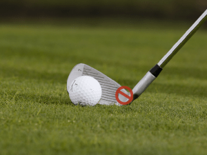 golf club and ball on grass, What causes a shank in golf